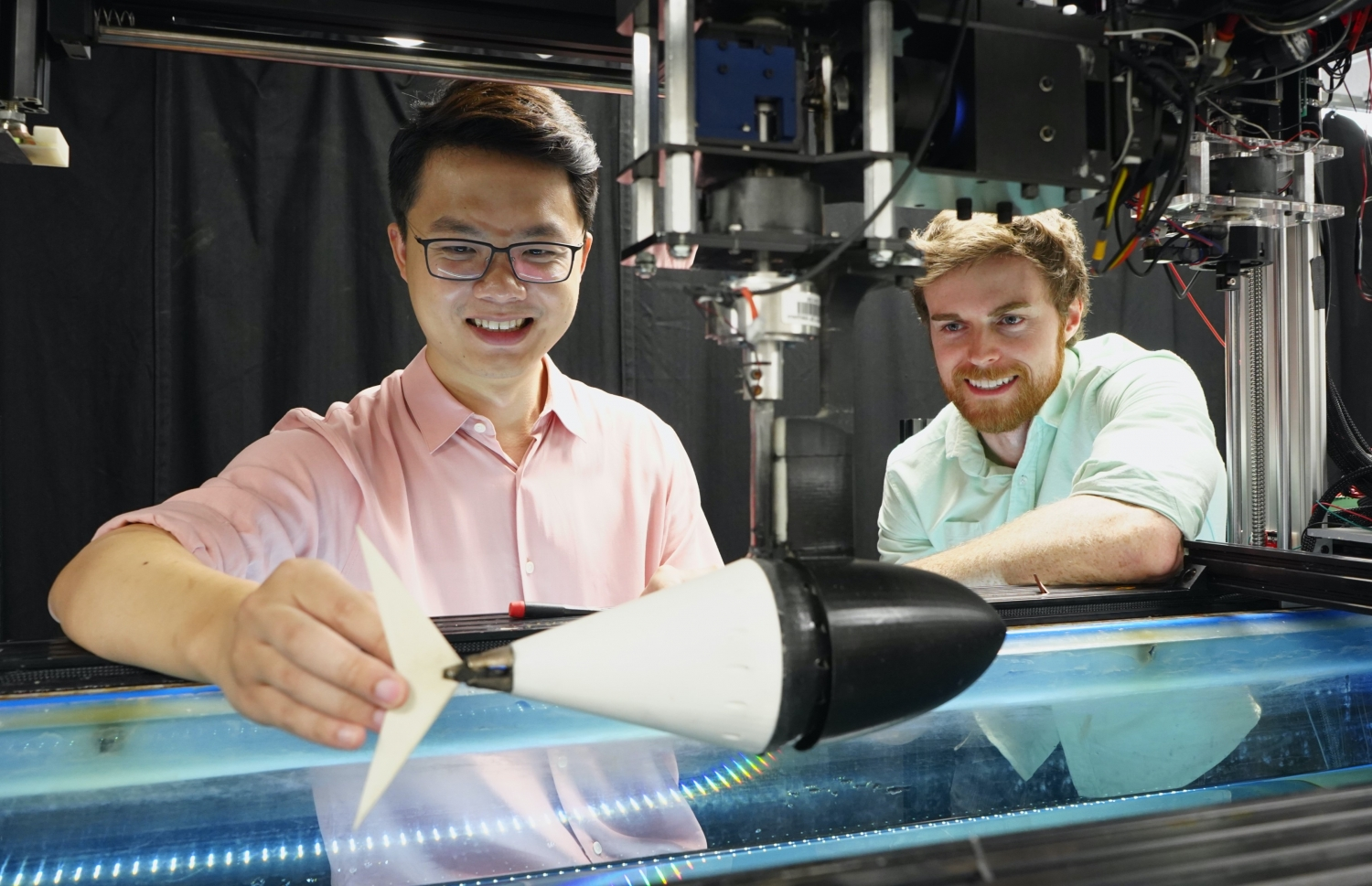 Assistant professor Dan Quinn, right, and postdoctoral researcher Qiang Zhong with the robotic tuna they designed to have a tail with tunable stiffness.