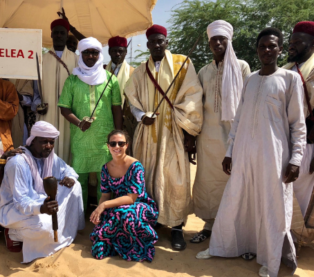 UVA alumna Chloe Rento in Chad with a traditional dance group at a festival