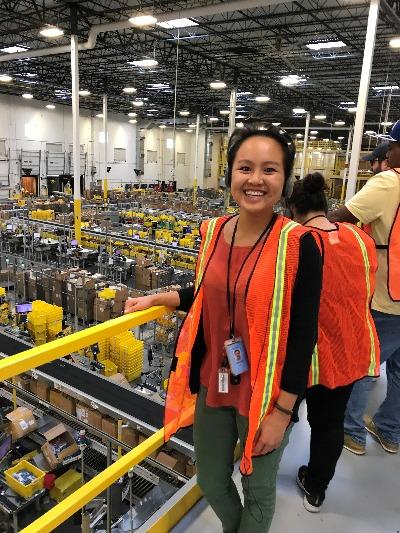 UVA alumna Jessica Lin inside an Amazon fulfillment center