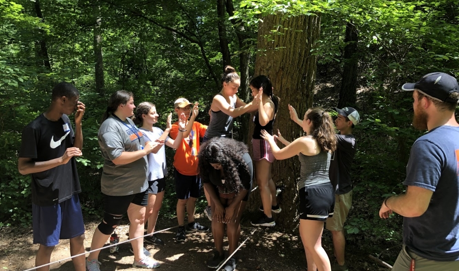 Cohort 2 spends their third day of the Scholar Retreat supporting each other on the low and high ropes.