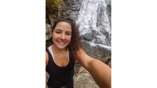 Ashley Conley at waterfall in Shenandoah National Park