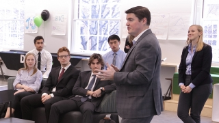 Eric Bristow addressing students at Deloitte Consulting National Undergraduate Case Competition