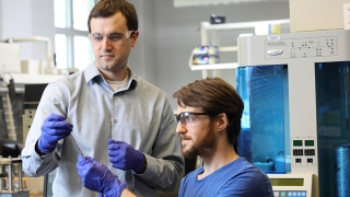 Gary Koenig and student in lab