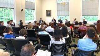 Panelists speak to symposium attendees