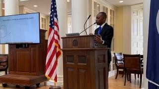 Dr. Kris Rawls defending his PhD dissertation in the Rotunda.