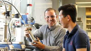 Geoff Geise with Kevin Chang in lab