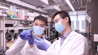 Shifeng Nian and Ph.D. student Jinchang Zhu load the ink into a syringe for 3D printing.