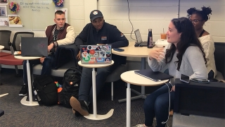 UVA Engineering students gather together in a shared workspace