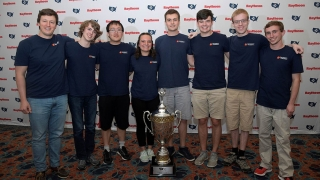 2019 UVA Cyber Defense Team photo with national title trophy
