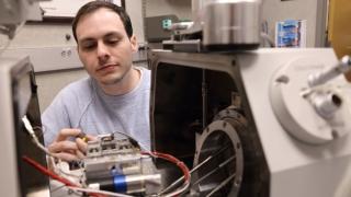 David Roache calibrates a field emission scanning electron microscope