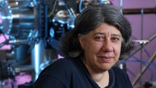 Professor Reinke behind her labs scanning tunneling microscope