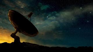 Stock image of radio telescope pointing to night sky