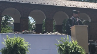 AMP graduate Zachary Fenn addresses the audience at the Systems Engineering siploma ceremony