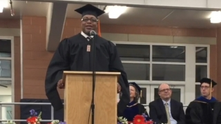 AMP graduate Korey Mitchell speaks at the 2017 systems engineering diploma ceremony