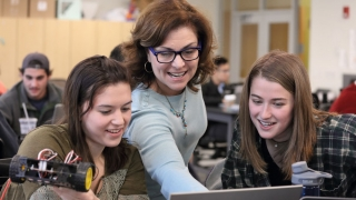 UVA Engineering Professor Ann Reimers works with students in an engineering class.