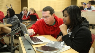 UVA Computer Science Professor Mark Sherriff works with a student
