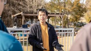 Professor Tomonari Furukawa having a team talk on the field.