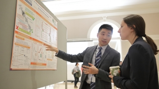 "Chemical Engineering Ph.D. student Yuntao ""Kevin"" Gu explains the catalysis research his is working on in Professor William S. Epling's lab during the 2019 University of Virginia Engineering Research Symposium, known as UVERS. In 2020 the annual symposium, in its 16th year, was moved to an online format because of the covid-19 pandemic."