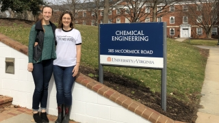 Bev  Miller and Rebecca Earhart pose next the chemical engineering sign