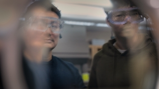UVA Engineering professor Kyusang Lee talks with a student about memristor technology